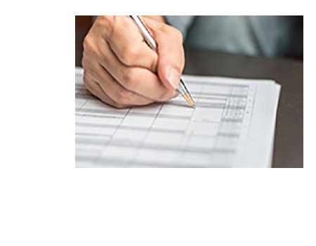 Picture of hand filling out forms